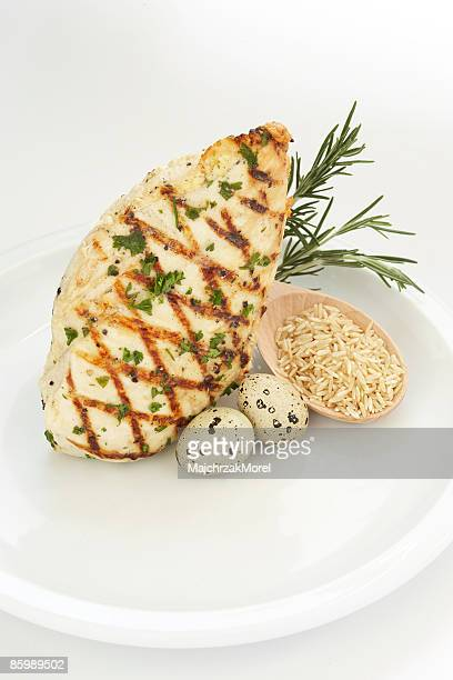Chicken, Eggs and Brown Rice on White Plate