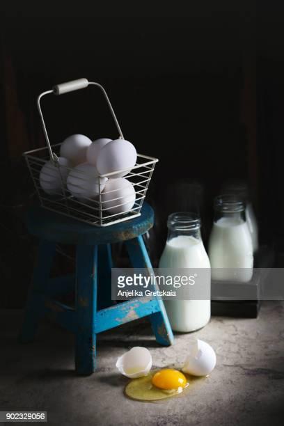 Chicken eggs. One egg is broken.
