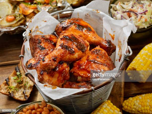bbq chicken feast - fried chicken stock photos and pictures