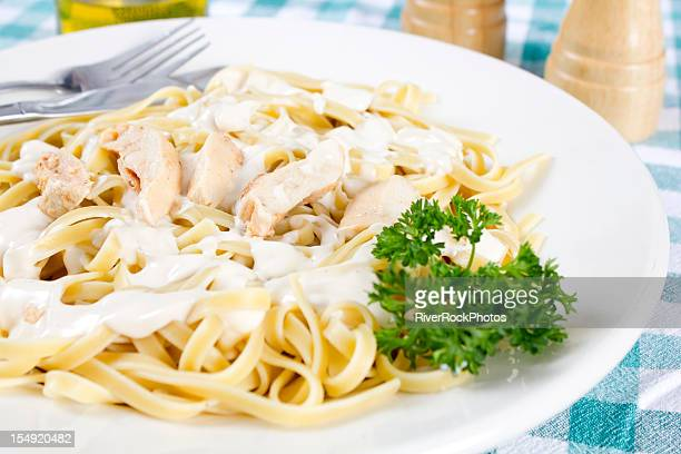 chicken fettuccine alfredo - bechamel sauce stock photos and pictures