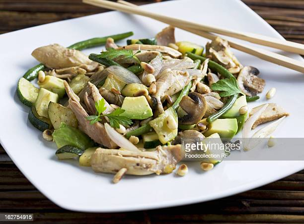 Chicken fillet with avocado, courgette, shallots and pine nuts, Asia