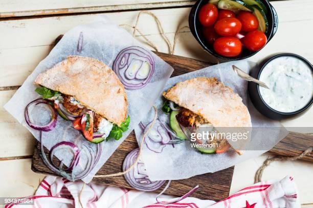 chicken gyros, chicken, salad, tomato, cucumber, onion, tzatziki, homemade glutenfree pita bread - greek food stock pictures, royalty-free photos & images