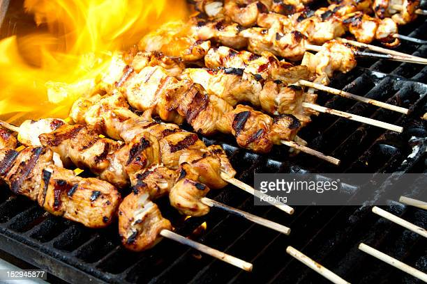 Chicken kabobs on a flaming grill