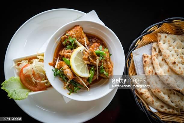 chicken karahi dish. - pakistani culture stock photos and pictures