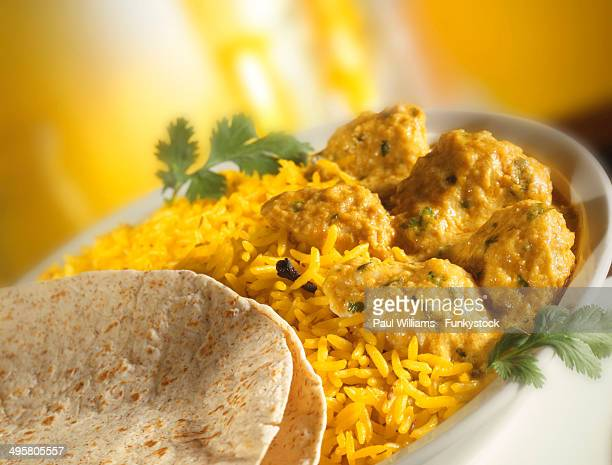 Chicken Korma, Pilaf rice and Naan bread