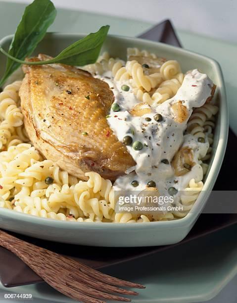 Chicken leg with fusillis and cream sauce