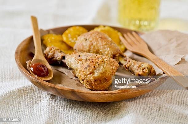 Chicken legs with fried bananas