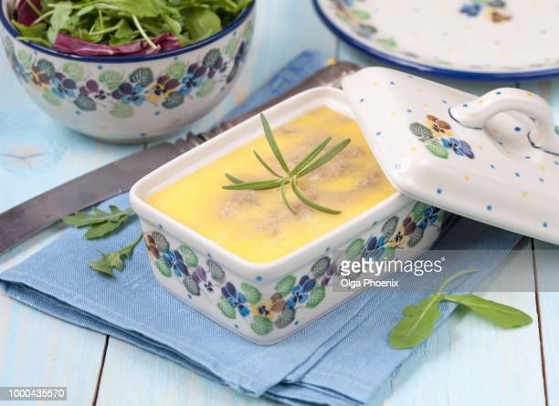 chicken liver pate with butter and thyme in ceramic form and gre - chilli crab stock photos and pictures