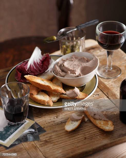 Chicken liver pate with crusty bread and radicchio on plate