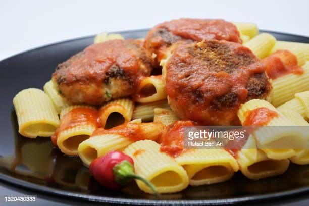 chicken meatballs on panini pasta and tomato sauces - rafael ben ari stockfoto's en -beelden