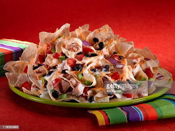 chicken nachos - nachos stock photos and pictures