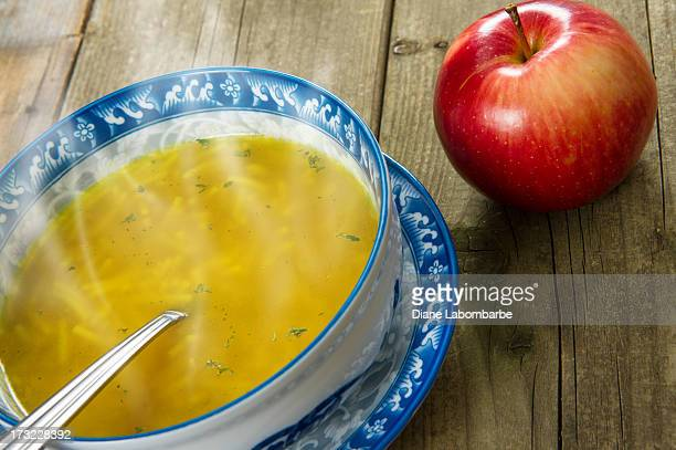 Chicken Noodle Soup And Apple On Wood