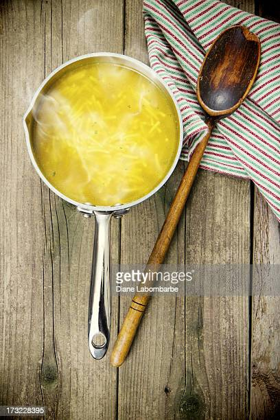 Chicken Noodle Soup On Old Wood Background