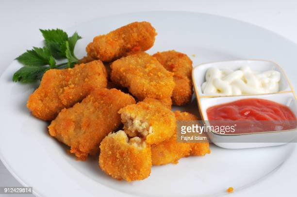 chicken nuggets - nuggets stock photos and pictures