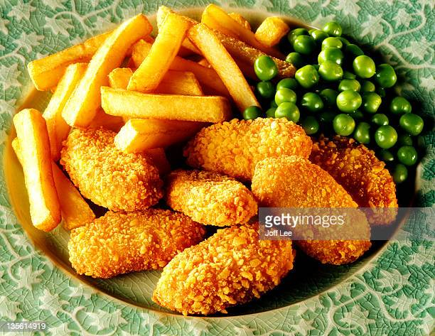 Chicken nuggets with chips & peas