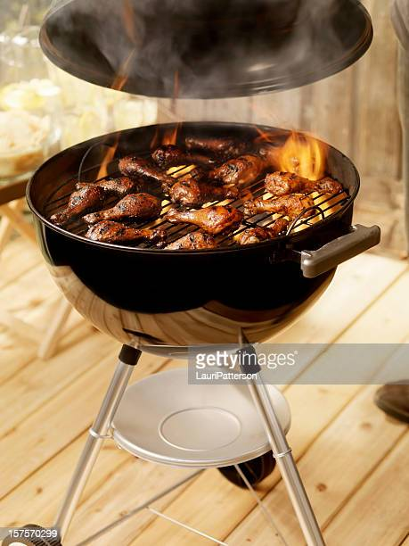chicken on a charcoal bbq - lid stock photos and pictures