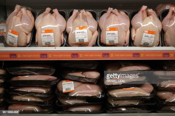 Chicken packaged in plastic is pictured in a supermarket in north London, on April 27, 2018. - 42 firms, responsible for 80 percent of plastic...