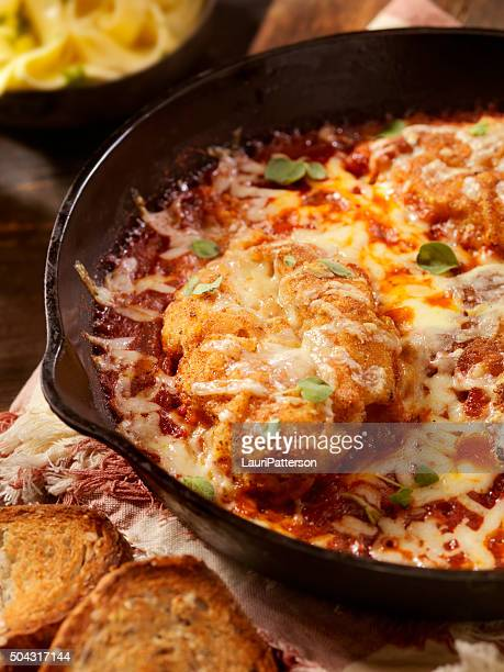 chicken parmesan baked in tomato sauce with mozzarella cheese - parmesan cheese stock pictures, royalty-free photos & images