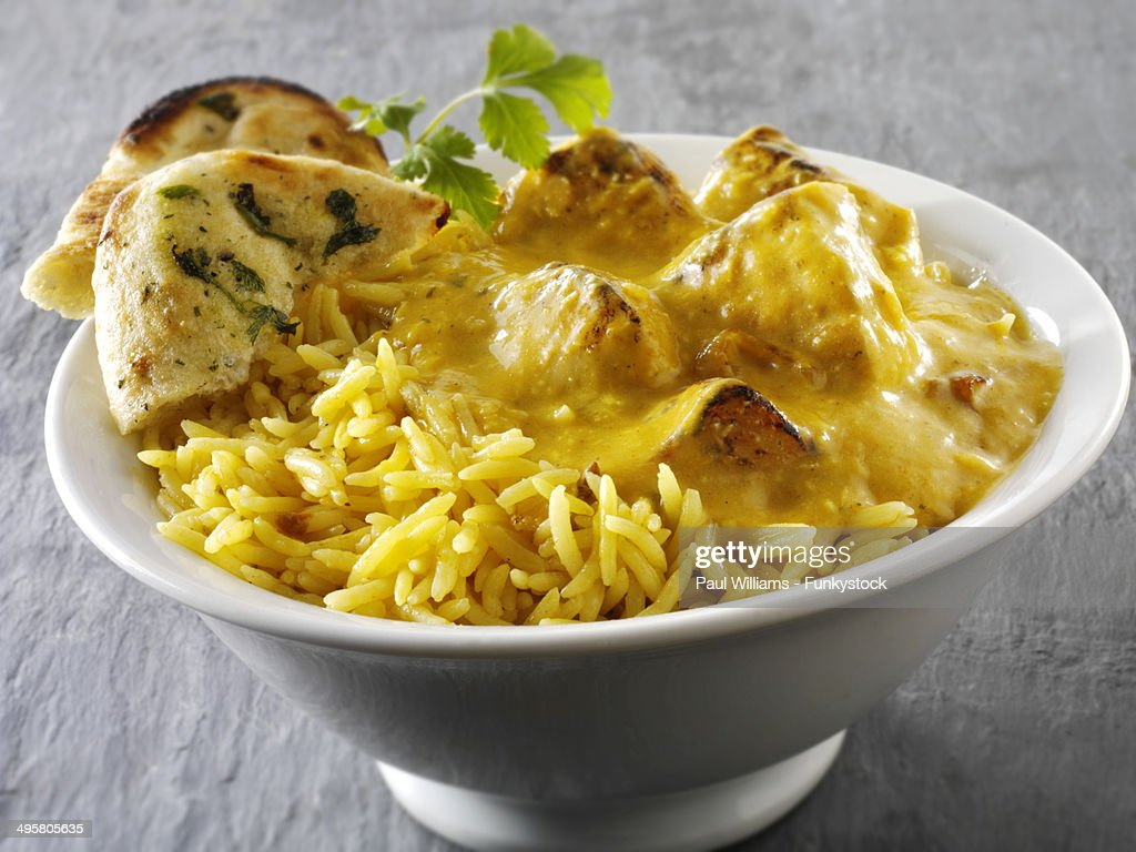 Chicken Passanda curry, pilau rice and naan bread : Stock Photo