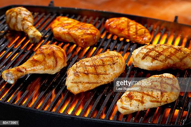 chicken pieces on grill - chicken meat stock pictures, royalty-free photos & images