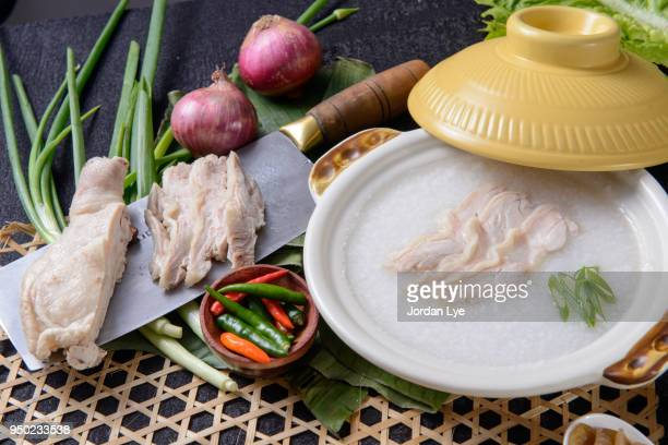chicken porridge - congee stock photos and pictures