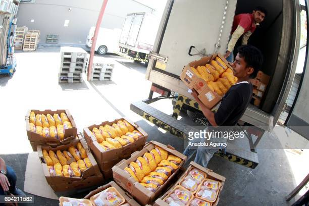 Chicken products are being unloaded at Al Meera market in Doha Qatar on June 9 2017 People only rushed to markets and stocked food until the shelves...