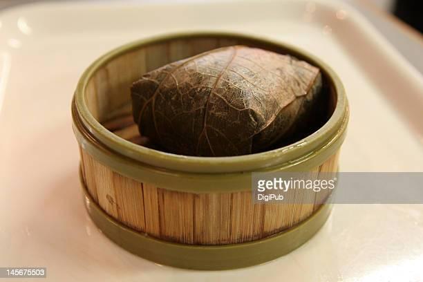 Chicken rice dumpling wrapped in lotus leaf