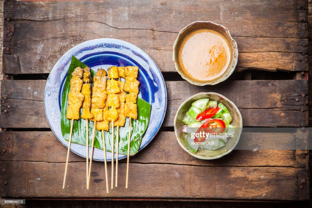 chicken satay grilled on grills plate with smoke : Stock Photo