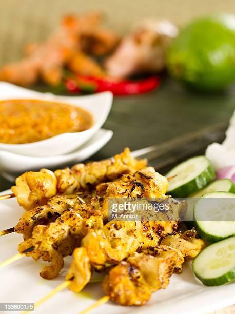 Chicken satay on white tray