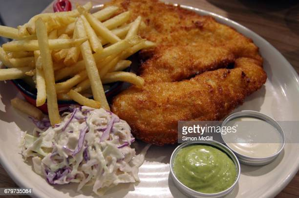 Chicken schnitzel served with potato fries, coleslaw and two mayonnaises, one wasbi, one regular.