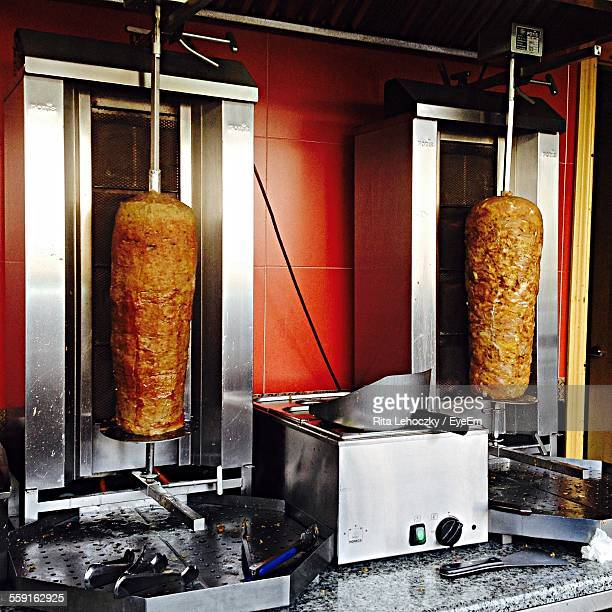 Chicken Shawarma Meat Roasting On Spit At Restaurant