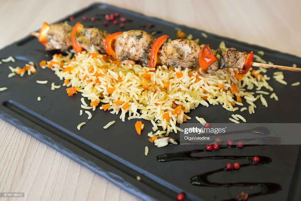 Chicken shish kebab and rice with vegetables : Photo