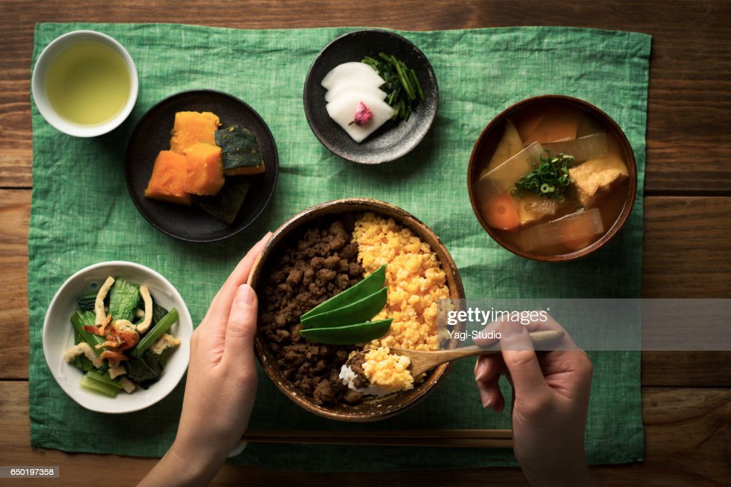 Chicken soboro and scrambled eggs and tepary bean with Bowl of rice dishes. : Stock Photo