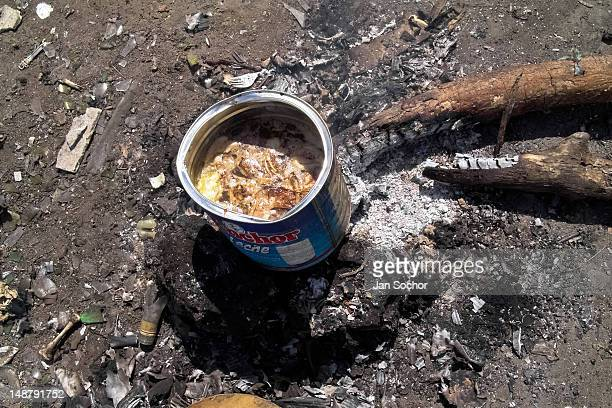 A chicken soup boiled in a can in the garbage dump La Chureca on 9 November 2004 in Managua Nicaragua La Chureca is the biggest garbage dump in...