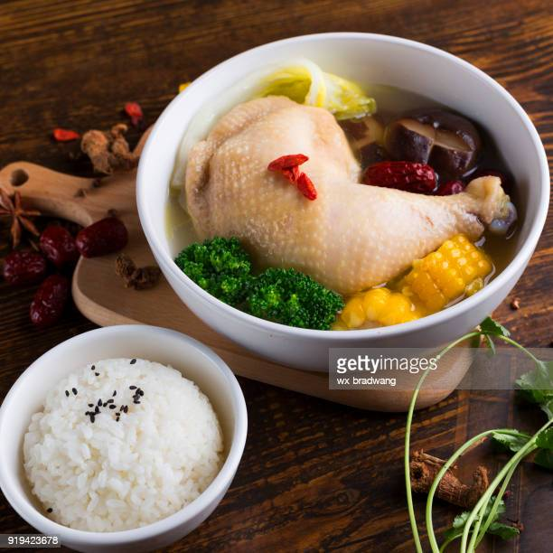 chicken soup - samgyetang stock photos and pictures