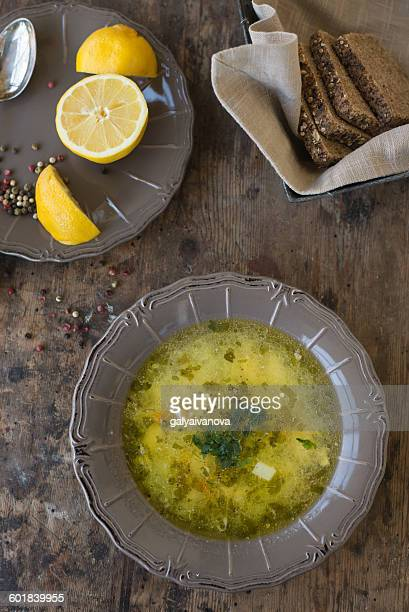 chicken soup with rye bread and lemon - chicken soup stock photos and pictures