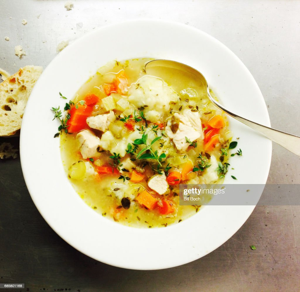 Chicken soup with thyme and crusty bread : Stock Photo