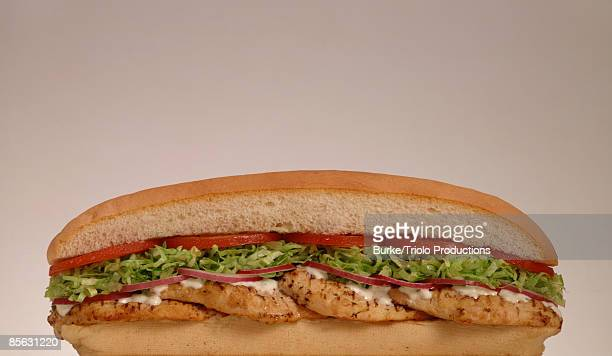 chicken sub sandwich - grinder sandwich stock pictures, royalty-free photos & images