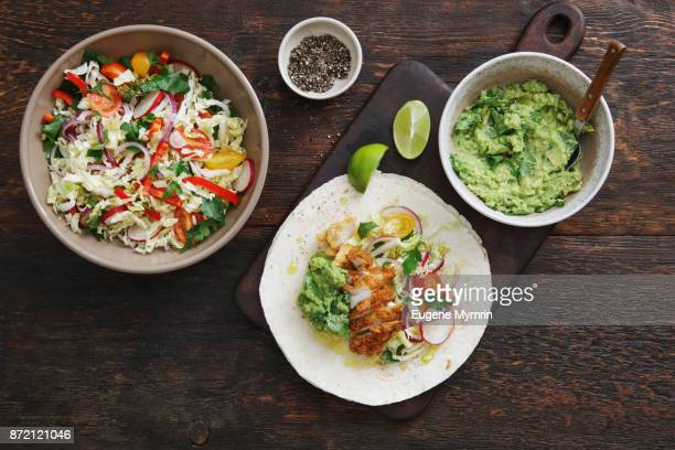 chicken taco with guacamole and mixed vegetables - mexican food stock pictures, royalty-free photos & images