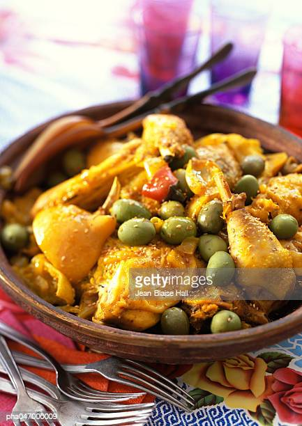 Chicken tagine, with green olives, in bowl, close-up