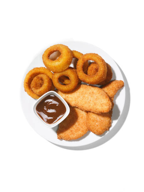 Chicken Tenders and onion rings with bbq sauce