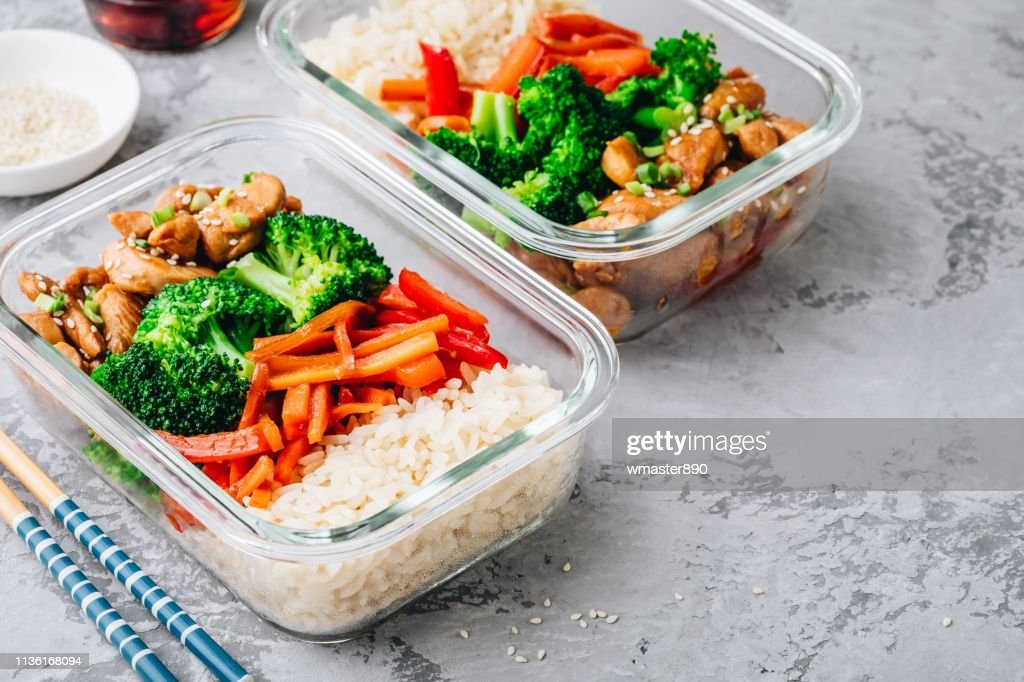 Chicken teriyaki meal prep lunch box containers with broccoli, rice and carrots : Stock Photo