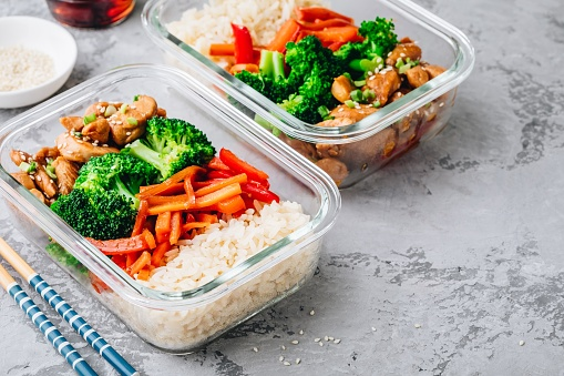 Chicken teriyaki meal prep lunch box containers with broccoli, rice and carrots 1136168094