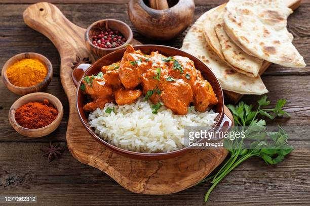 chicken tikka masala spicy curry meat food in a clay plate with rice - tikka masala stock pictures, royalty-free photos & images
