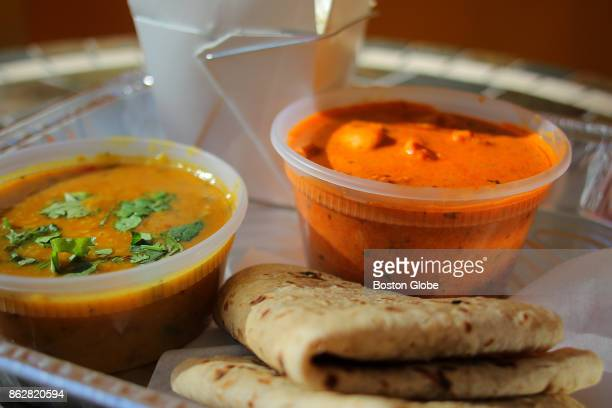 Chicken tikka masala with tadka dal rice and naan is pictured at Guru the Caterer in Somerville MA on Oct 12 2017