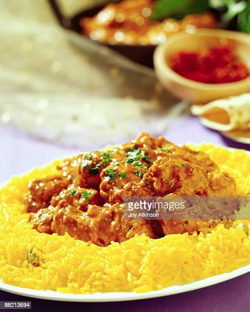 chicken tikka masalla with pilau rice - chicken tikka stock photos and pictures