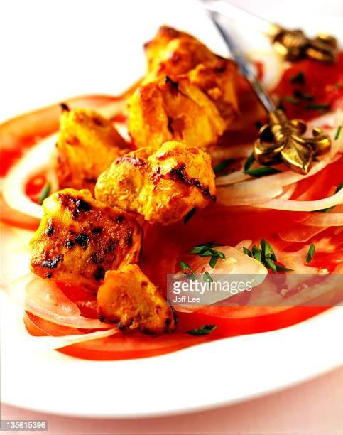 Chicken tikka shish kebab with tomato & onion salad