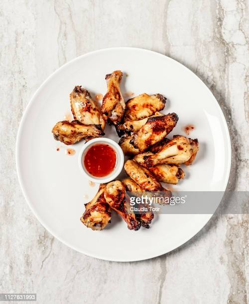 chicken wings - chicken wing stock pictures, royalty-free photos & images