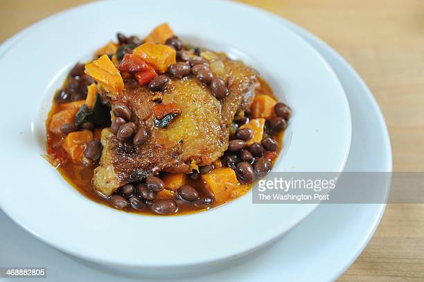 Chicken with Black Beans Spices and Sweet Potatoes as prepared by chef and coowner of CulinAerie Susan Holt is seen on Monday February 03 2014 in...