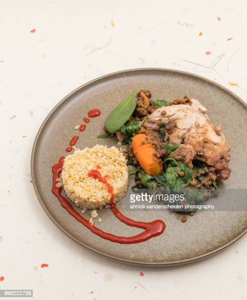 Chicken with lentils, spinach and bulgur.